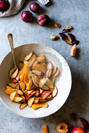 Peaches, Plums and nectarines being chopped for a dessert