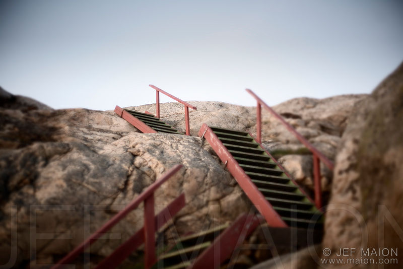 Wooden stairs on rock