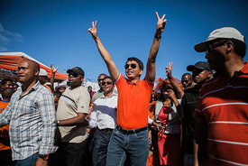 Madagascar's President Andry Rajoelina greets supporters of his political party at a rally for TGV (Tanora malaGasy Vonona) in Antananarivo on December 1, 2013 to round up support for his party's candidate for the 2nd round of the elections later this mouth.