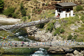 Wire suspension foot bridges and a traditional tower bridge over the Paro Chhu River.