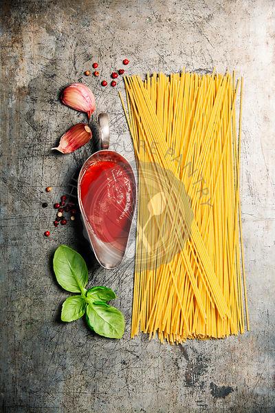 Ingredients for cooking spaghetti on rustic background. Italian food concept