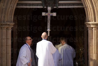 Clerics Checking that the Processional Cross fits Through the Main Entrance of Leicester Cathedral