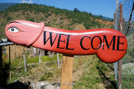 A phallus welcome sign near the Chime Lhakhang Monastery or temple, in Punakha District, Bhutan.