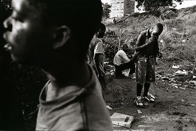 Angola - Luanda - Former combatants gather to drink and smoke drugs in a rubbish dump