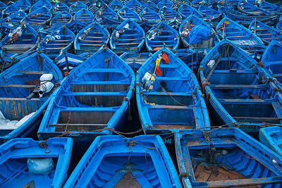 Blue boats docked in harbor