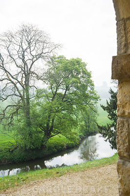 Views over the River Cherwell from the Praeneste, and arcaded building by William Kent. Rousham House, Bicester, Oxon, UK