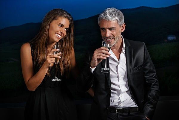 Couple drink a glass of champagne