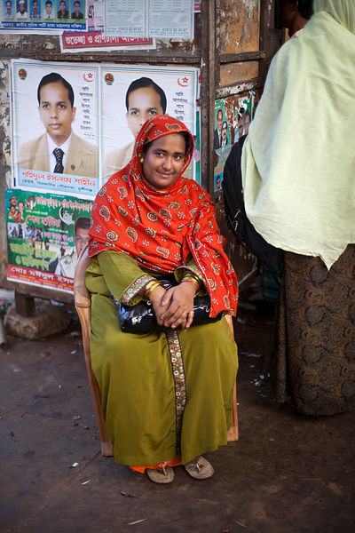 Bangladesh - Dhaka - A woman waits by a ferry at Sadarghat
