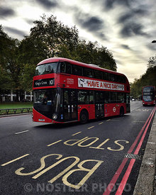 "London's iconic double-decker bus at Marble Arch and Hyde Park.  The New Routemaster, originally referred to as the New Bus for London and popularly known as the Boris Bus or Borismaster (a portmanteau of the name of the former Mayor of London, Boris Johnson, who drove their introduction, and that of the AEC Routemaster that they were designed to replace) is a hybrid diesel-electric double-decker bus operated in London. Designed by Heatherwick Studio, it is manufactured by Wrightbus, and is notable for featuring a ""hop-on hop-off"" rear open platform similar to the original Routemaster bus design but updated to meet requirements for modern buses to be fully accessible. The first bus entered service on 27 February 2012."