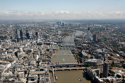 aerial photograph of the the River Thames London England UK showing the Thames bridges starting with Blackfriars Bridge behind which are , in order, Blackfriars Railway Bridge, Millenium Bridge, Southwark Bridge , Cannon Street Railway Bridge , London Bridge and Tower Bridge