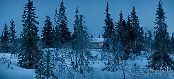 Winter night falling on wilderness hut