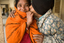 India - Delhi - A mentally ill man kisses his wife who visits him in the secure ward