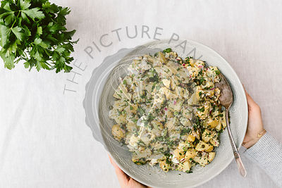 A large bowl of Potato Salad is photographed from the top vied