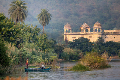 Storybook image of boaters near the Lake Palace in Jaipur, Rajasthan, India