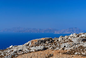 The mountainous interior of Chalki Island with Tilos Island in the distance, near Rhodes, Dodecanese Islands, Greece.