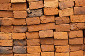 Sun dried bricks stacked and ready for use. Kenya.
