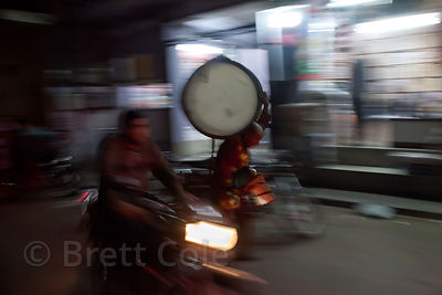 A man carries a drum through the streets of Jodhpur, Rajasthan, India