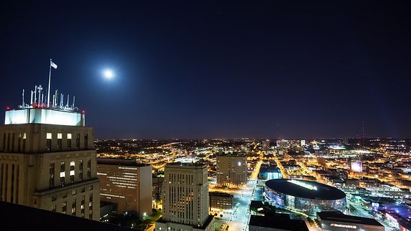Moving Medium Shot: Night Lights Over Kansas City's Sprint Center & Skyline