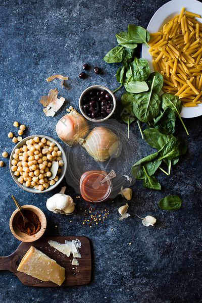 Ingredients for chickpea spinach pasta with olives (gluten-free quinoa penne).