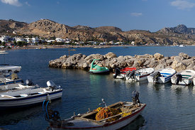 Boats moored in small harbour, Stegna, Archangelos, Rhodes, Dodecanese Islands, Greece.