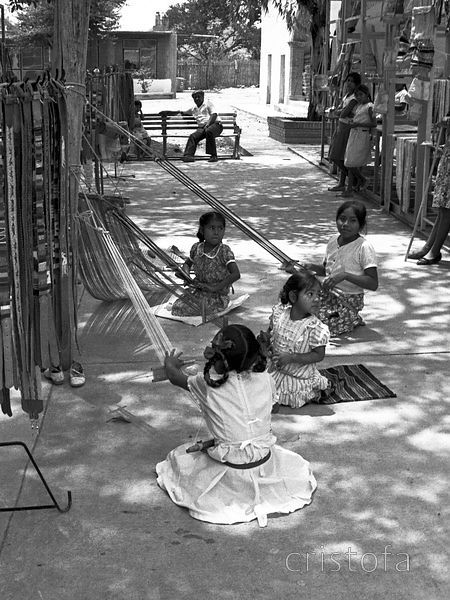 Young people backstrap weaving in Oaxaca