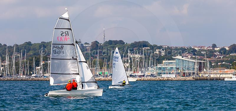 Racing in Poole Harbour with Parkstone Yacht Club in the background during Zhik Poole Week 2018