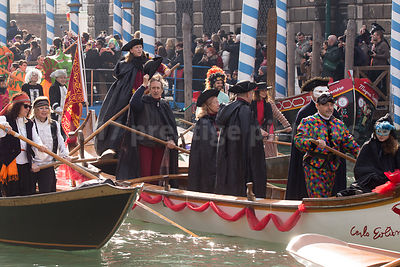 Man Raising his Tricorn Hat in the Venice Carnival Water Parade  on the Rio di Cannaregio Canal