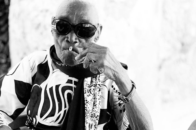 Zanzibar's legendary Taarab singer smokes a cigarette whilst wearing my sunglasses during an interview with Mambo magazine. 