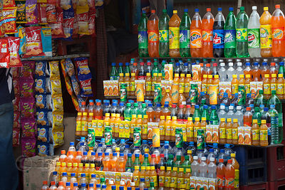 Racks of cold drinks (soft drinks) for sale near the Alipore Zoo, Kolkata, India.