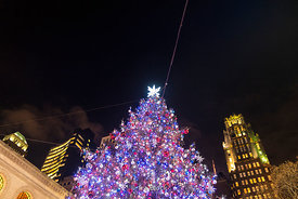 The decorated and lit Christmas Tree at Bryant Park Winter Village in Manhattan, New York