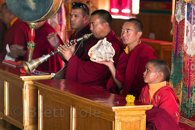 Buddhist monks play music during prayers in Matho Gompa, Ladakh, India