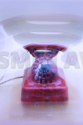 Old red telephone with marks and scratches Studio shot with lens zoom effect, the blur is not digital