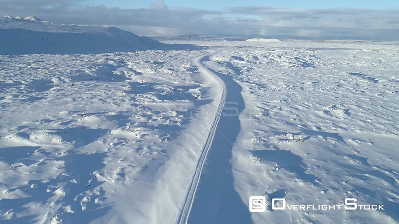Arctic Mountain Road Aerial High Over Snow Covered Lava Field Iceland Day