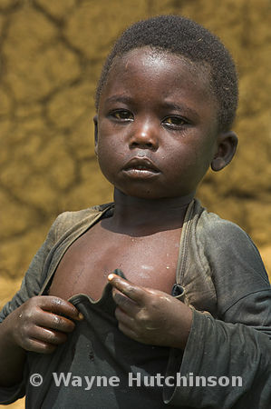 Poverty stricken young African boy, western Kenya, Africa