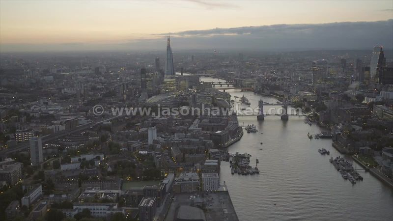 Aerial footage of River Thames and Tower Bridge ,London at dusk