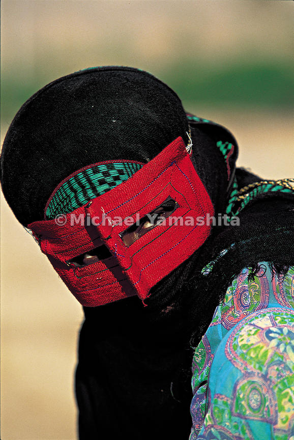 "Marco Polo wrote about the ""black-skinned people"" of the western coastal region of Iran along the Persian Gulf. Because the region's history as a center of trade, this area is one of the most ethnically mixed in the Middle East. Women here wear a thick, embroidered mask.  Minab, Iran"