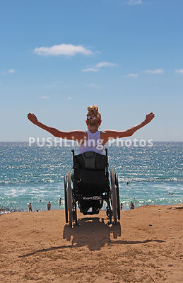 Woman using a wheelchair at the ocean