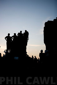 Siem Reap, Cambodia - Tourists watching the sunset over Angkor Wat.