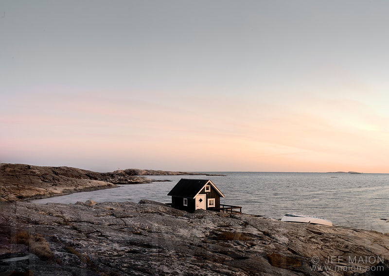 Isolated tiny house on rock by the sea
