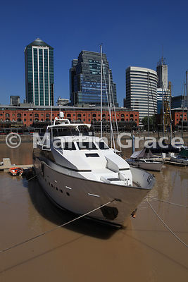 Puerto Madero docklands regeneration in Buenos Aires, Argentina, with high-rise buildings, old warehouses, and yachts in the marina