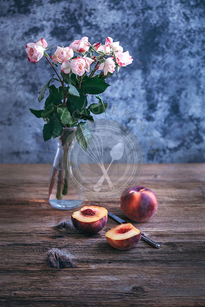 Fresh peaches on rustic wooden table