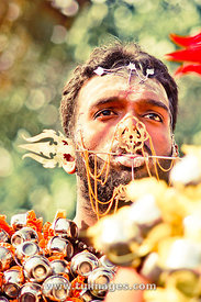 thaipusam devotee with face piercing
