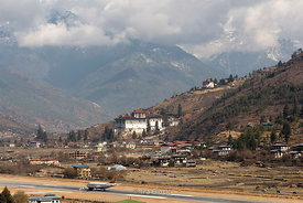 Paro Airport and Paro Dzong, also known as Rinpung Dzong which is a Drukpa Kagyu Buddhist monastery in Paro District, Bhutan.