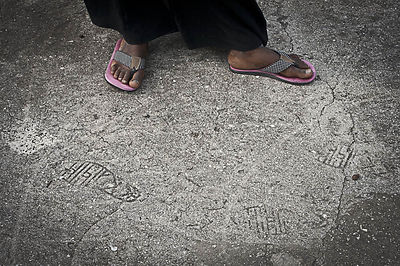 Fatmata Abdulrahman Mbamba, shows what is said to be the footprints of Abeid Amani Karume, the first president of Zanzibar, set into the cement floor of the roof of the flats and said to be made during his first official visit. Karume, was shot dead at his home on April 7, 1972.