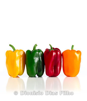 Bell Peppers of Different Colours in Line