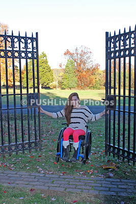 Young woman in a wheelchair in a park during Fall