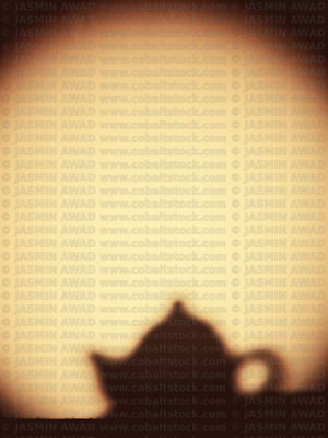 Shadow of small teapot on the wall with copy space..Digital filter applied