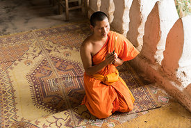 A monk praying at the Pak Ou caves near the Mekong River in Laos.