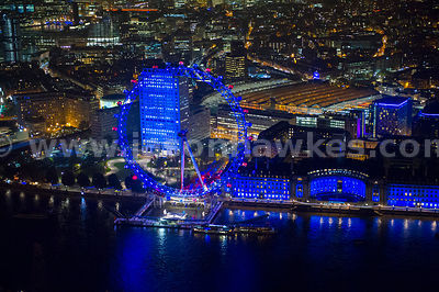 Aerial view of the London Eye and County Hall at night, London