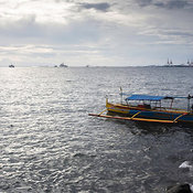 Manila Bay with small fishing boat, Manila, Philippines
